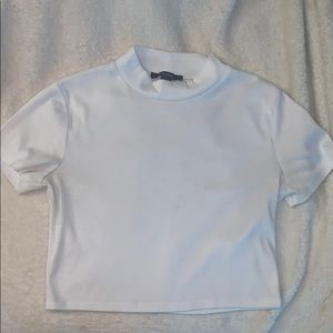 A white belly shirt/crop top from Forever 21.
